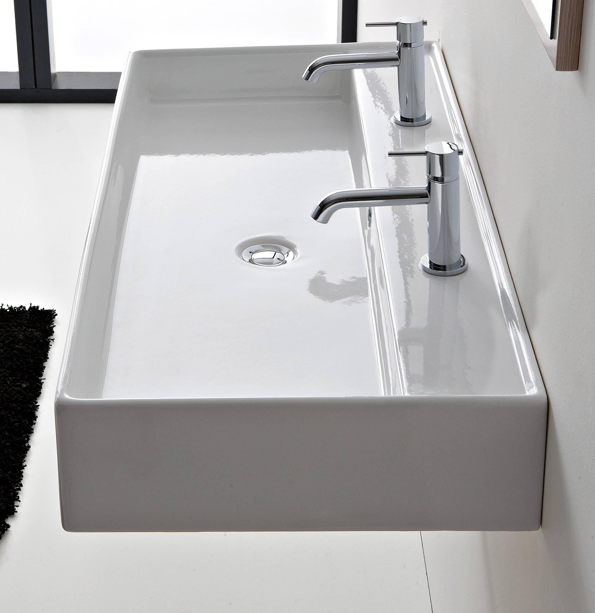 lavabo da appoggio o sospeso con due fori rubinetto teorema scarabeo ins2